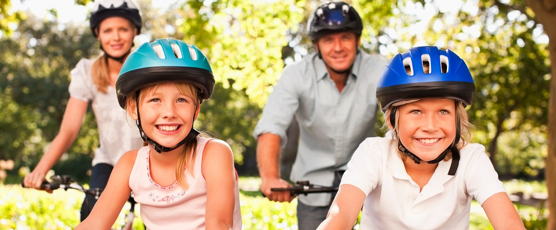Family enjoy a bike ride